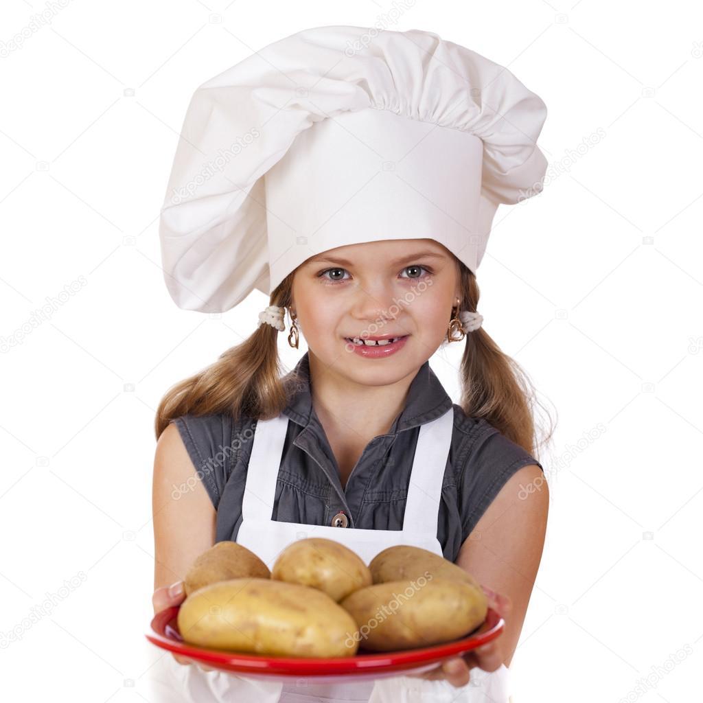 Concetto di cucina e persone - bambina sorridente in cappello del cuoco–  immagine stock 28cb09d3a55a