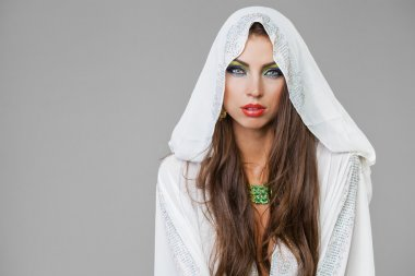 Portrait of the young sexy woman in white tunic Arabic