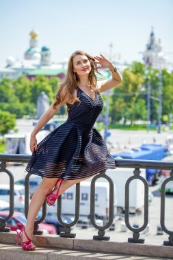 Young beautiful woman in fashion black dress