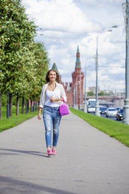 Happy  beautiful woman in blue jeans
