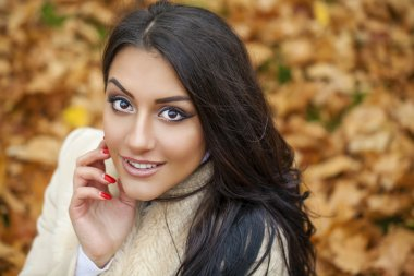 Facial portrait of a beautiful arab woman warmly clothed outdoor