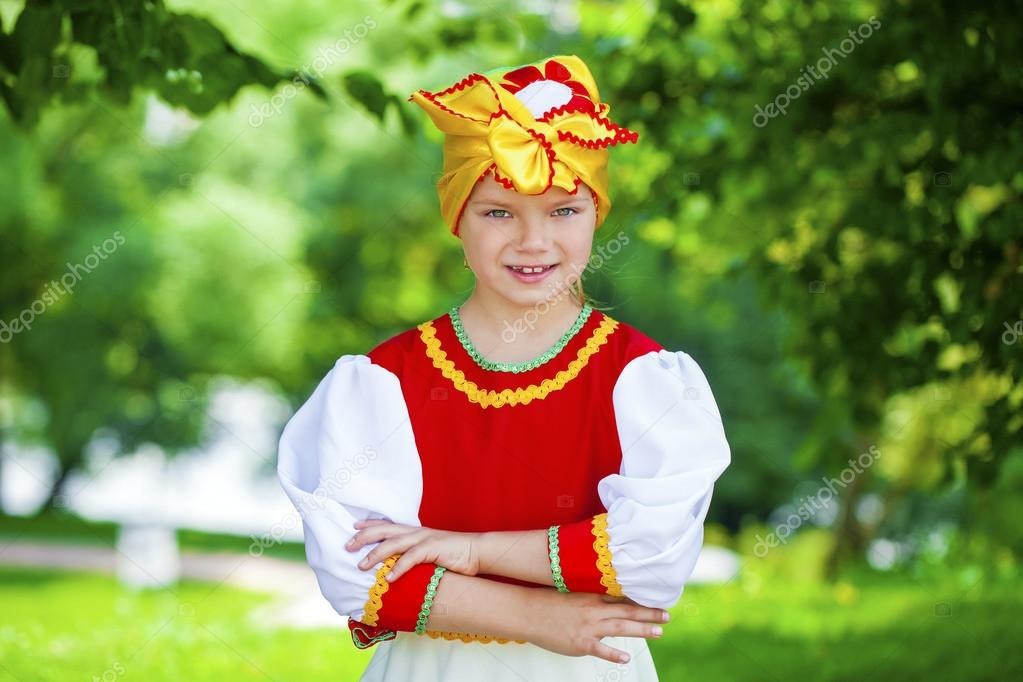 Little girl is dressed in the Russian national dress in summer p
