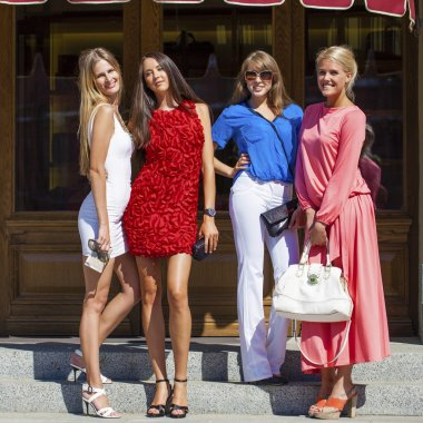 Group of happy smiling women shopping