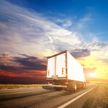 truck with freight moving fast