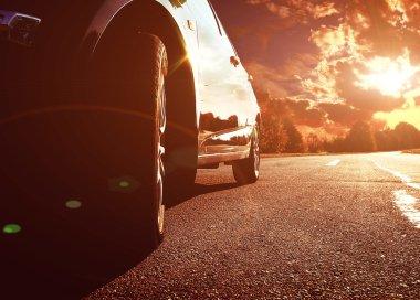 Black car driving fast