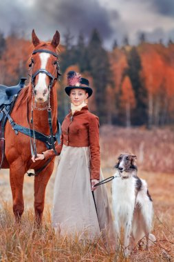 Lady in riding habbit  at horse hunting