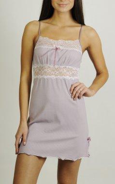 Beautiful woman in satin nightdress posing in studio stock vector