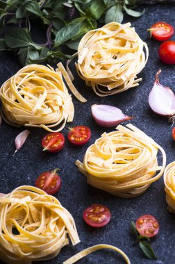 pasta nests, vegetables and herbs
