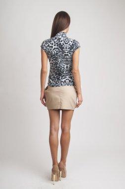 girl wearing t shirt and mini skirt