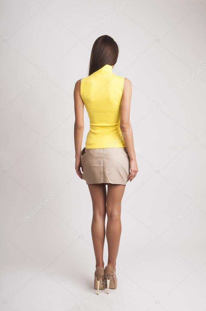 Фото девушек сзади мини юбках