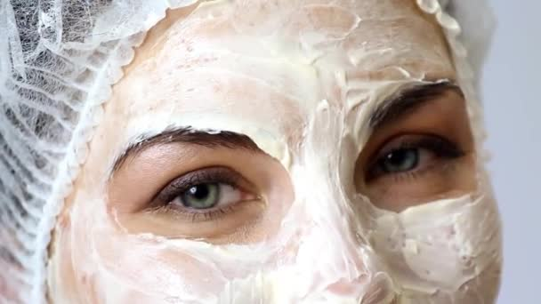 Relaxed woman with a deep cleansing nourishing face mask