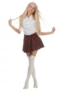 Young and beautiful schoolgirl is wearing a traditional uniform