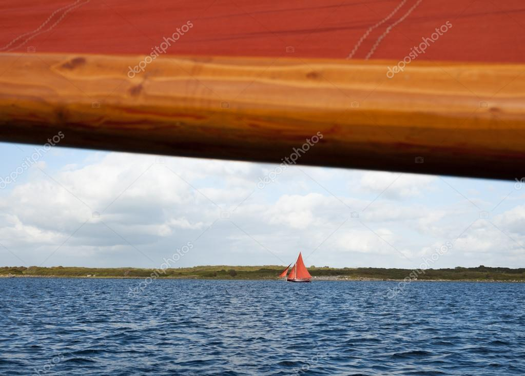 Wooden boat with sail