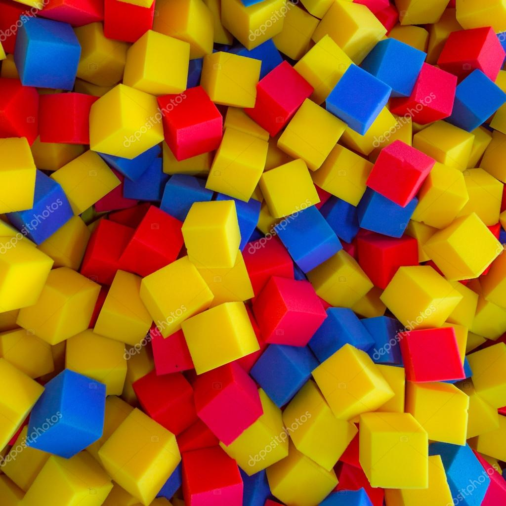 colored foam rubber cubes background ストック写真 gilmanshin