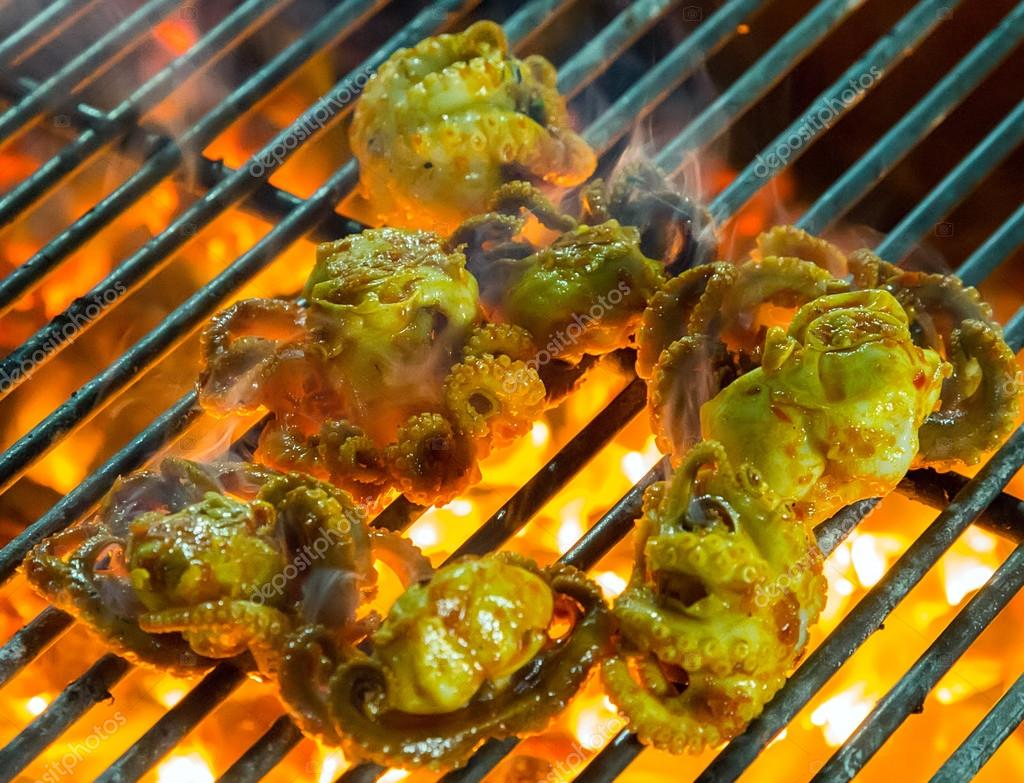 Grilled seafood on grill
