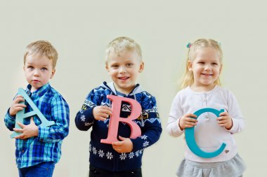 toddlers  with letters abc