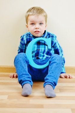 boy with  wooden letter