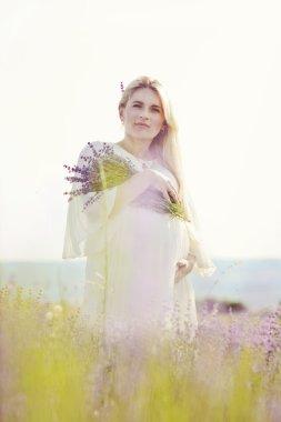 pregnant woman in a lavender field