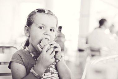 little girl with a hamburger