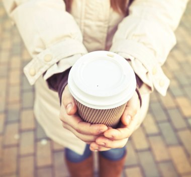 Female hands with cup of coffee