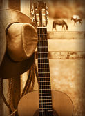Photo Cowboy hat and guitar.American music background