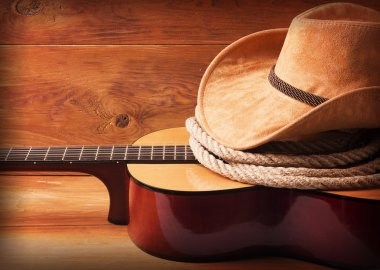 Country music picture with guitar and cowboy hat