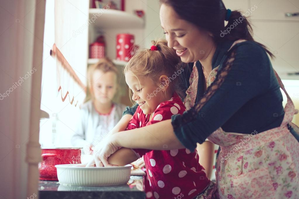 Mother with her 5 years old kids cooking holiday pie in the kitchen, casual lifestyle photo series in real life interior stock vector