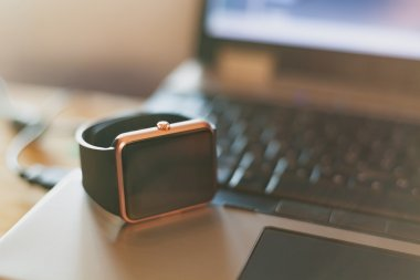 Smart wrist watch on the notebook