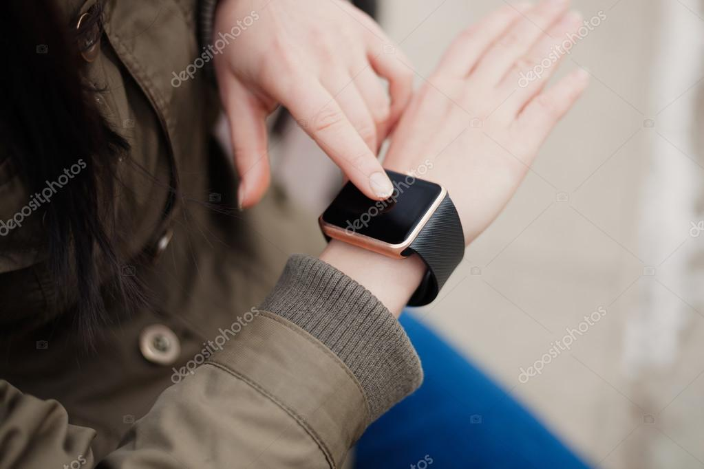 Hands of a girl using her smart watch — Stock Photo ...