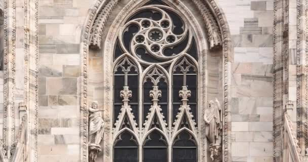 Duomo di Milano filmed in close up video clip. Beautiful catholic cathderal in center of Milan,Italy. Main Italian christian temple in Lombardia,famous tourist landmark