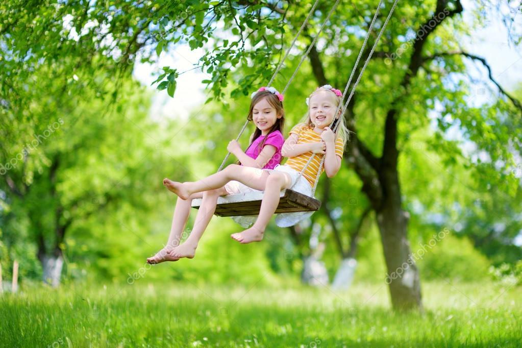 https://st2.depositphotos.com/1000917/11504/i/950/depositphotos_115043248-stock-photo-little-sisters-having-fun-on.jpg