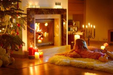 Girl near fireplace