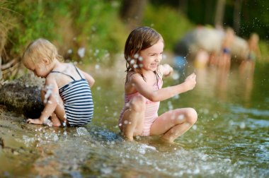 sisters in summer river