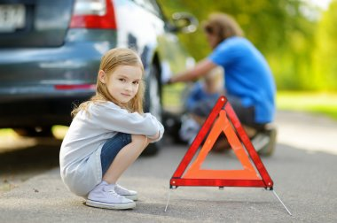 Girl with red warning triangle sign