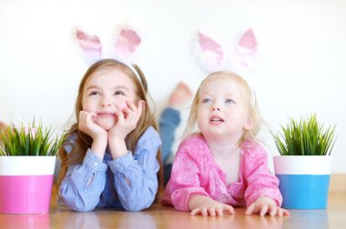 Little sisters with Easter bunny ears