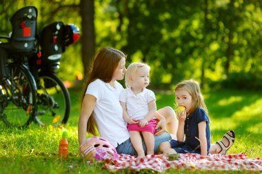 Mother and daughters having picnic
