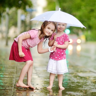 Little  sisters with umbrella