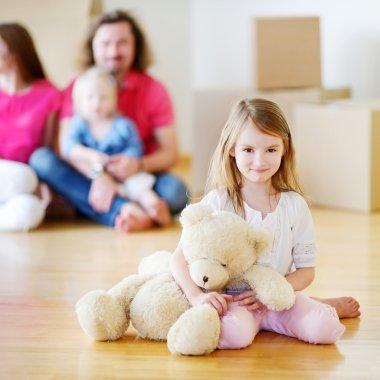 Preschooler girl with parents