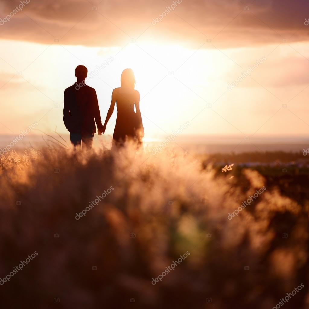 Young couple enjoying sunset