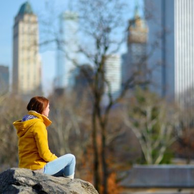 woman looking at skyscrapers in Central Park