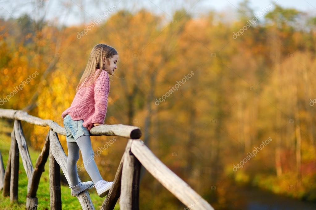 little girl on autumn day