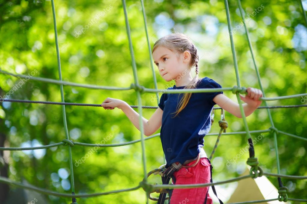 Little girl  in adventure park