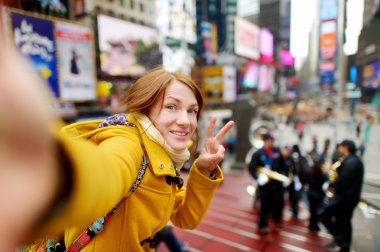 woman taking  selfie on Times Square