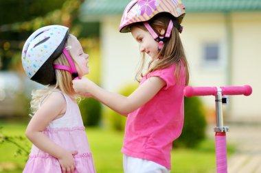 Little girl helping her sister