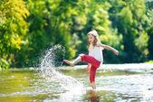 Fotografie girl having fun by a river