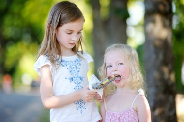 sisters eating belgian waffle