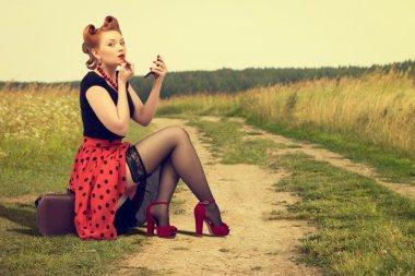 Woman  painting lipstick.