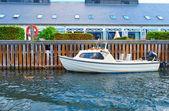 Fotografie A motorboat near quaysidenear in Copenhagen, Denmark.