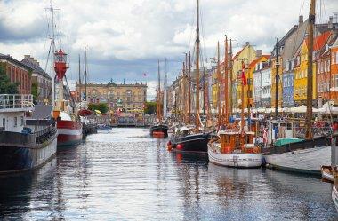 The historical ships in Nyhavn (New Harbour), Copenhagen, Denmark. stock vector