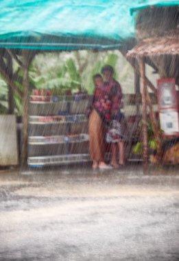 Couple under veavy rain